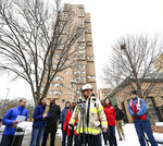 Minneapolis Fire Department Chief John Fruetel speaks to the media in front of the building at 630 Cedar Avenue where an early morning fire killed multiple people Wednesday, Nov. 27, 2019 in Minneapolis. Residents of the high rise were evacuated early Wednesday after a fire broke out on the 14th floor of the building.  (Aaron Lavinsky/Star Tribune via AP)