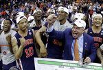 Auburn head coach Bruce Pearl celebrates with his team after the Midwest Regional final game against Kentucky in the NCAA men's College basketball tournament Sunday, March 31, 2019, in Kansas City, Mo. Auburn won 77-71 in overtime. (AP Photo/Charlie Riedel)