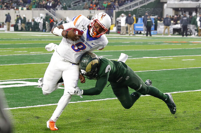 Boise State quarterback Jaylon Henderson, left, runs for a touchdown past Colorado State safety Jamal Hicks in the second half of an NCAA college football game Friday, Nov. 29, 2019, in Fort Collins, Colo. Boise State won 31-24. (AP Photo/David Zalubowski)