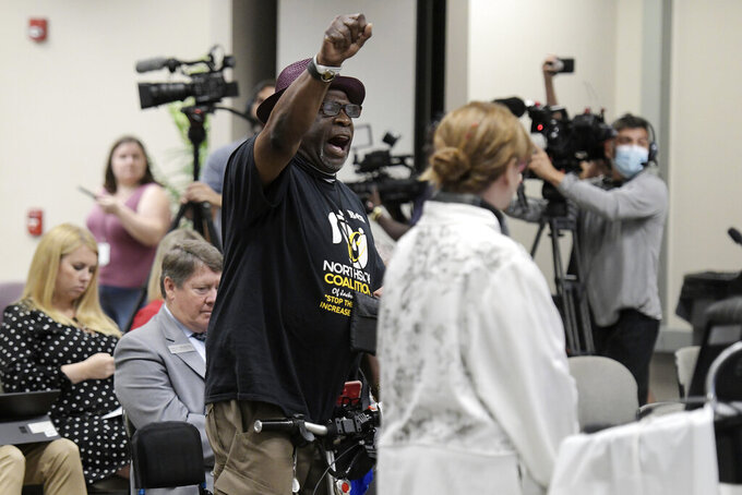 """FILE - In this June 10, 2021, file photo, Ben Frazier, the founder of the Northside Coalition of Jacksonville chants """"Allow teachers to teach the truth"""" at the end of his public comments opposing the state of Florida's plans to ban the teaching of critical race theory in public schools during the Department of Education meeting in Jacksonville, Fla. Laws setting guiderails for classroom instruction on race passed this year in Republican-controlled states have left some teachers worried about how they will be enforced. (Bob Self/The Florida Times-Union via AP, File)"""