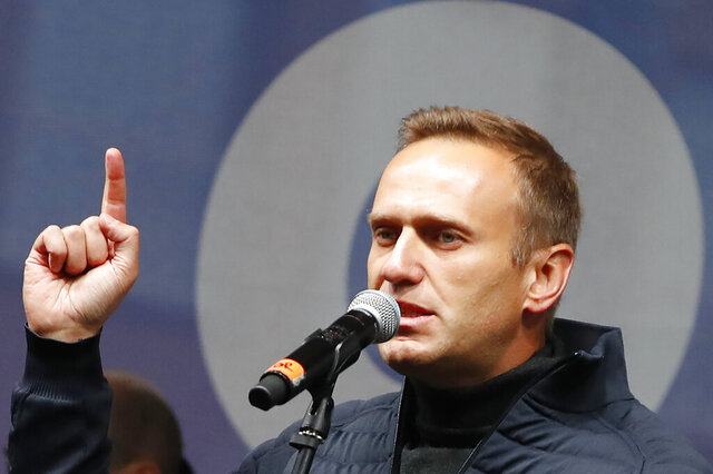 FILE - In this Sunday, Sept. 29, 2019 file photo Russian opposition leader Alexei Navalny speaks during a rally to support political prisoners in Moscow, Russia. The German hospital treating Russian opposition leader Alexei Navalny says he has been taking out of an induced coma and is responsive. Berlin's Charite hospital said Monday that Navalny's condition has further improved, allowing doctors to end the medically induced coma and gradually ease him off mechanical ventilation. (AP Photo/Dmitri Lovetsky, File)