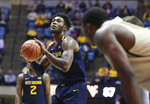West Virginia's Derek Culver looks to shoot against Akron during an NCAA college basketball game, Friday, Nov. 8, 2019, in Morgantown, W.Va. (AP Photo/Kathleen Batten)