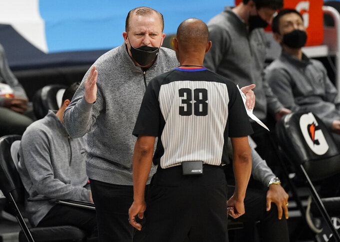 New York Knicks head coach Tom Thibodeau, back, argues for a call with referee Michael Smith in the second half of an NBA basketball game against the Denver Nuggets Wednesday, May 5, 2021, in Denver. (AP Photo/David Zalubowski)