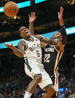 Milwaukee Bucks guard Eric Bledsoe (6) is defended by Atlanta Hawks forward Cam Reddish (22) in the first half of an NBA basketball game, Wednesday, Nov. 20, 2019, in Atlanta. (AP Photo/Brett Davis)
