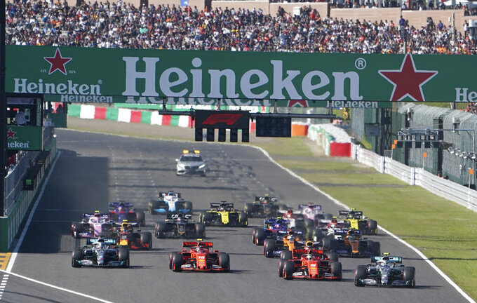 Mercedes driver Valtteri Bottas, right, of Finland passes Ferrari driver Sebastian Vettel of Germany at the start of the Japanese Formula One Grand Prix at Suzuka Circuit in Suzuka, central Japan, Sunday, Oct. 13, 2019. (AP Photo/Toru Hanai)