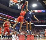 Louisville center Malik Williams (5) battles Notre Dame guard D.J. Harvey (5) for a rebound during the second half of an NCAA college basketball game in Louisville, Ky., Sunday, March 3, 2019. Louisville won 75-61. (AP Photo/Timothy D. Easley)