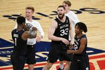 Butler's Bryce Golden (33) celebrates with teammates Bo Hodges (1) and Myles Tate (12) after an NCAA college basketball game against Xavier in the Big East conference tournament Wednesday, March 10, 2021, in New York. Butler won 70-69. (AP Photo/Frank Franklin II)