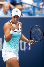 Ashleigh Barty, of Australia, reacts during her match against Maria Sharapova, of Russia, at the Western & Southern Open tennis tournament Wednesday, Aug. 14, 2019. in Mason, Ohio. (Meg Vogel/The Cincinnati Enquirer via AP)