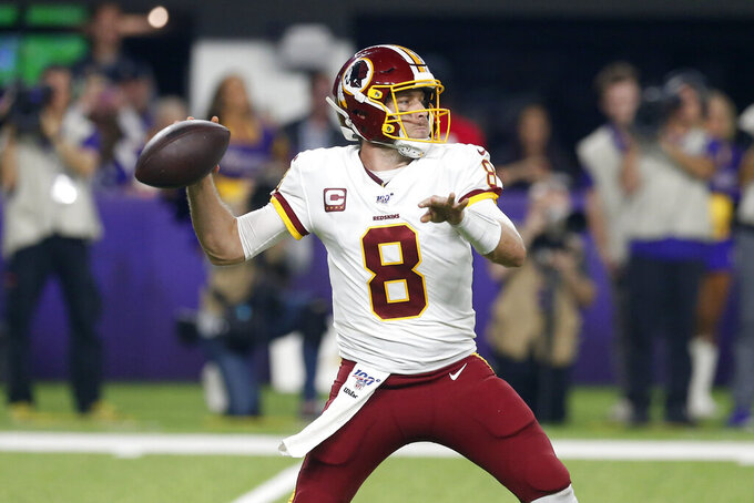 Washington Redskins quarterback Case Keenum throws a pass during the first half of an NFL football game against the Minnesota Vikings, Thursday, Oct. 24, 2019, in Minneapolis. (AP Photo/Jim Mone)