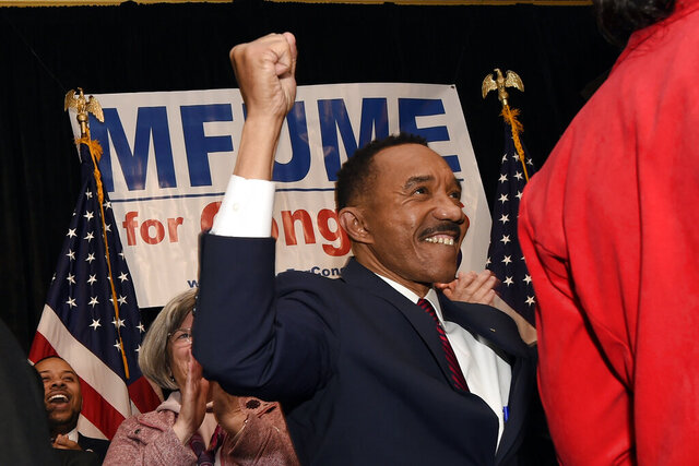 Kweisi Mfume, Democratic nominee for Maryland's 7th Congressional District, raises his fist at a victory party, Tuesday, Feb. 4, 2020, in Baltimore. (AP Photo/Gail Burton)