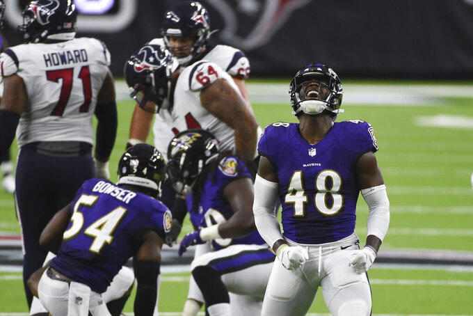 Baltimore Ravens linebacker Patrick Queen (48) celebrates after sacking Houston Texans quarterback Deshaun Watson during the first half of an NFL football game Sunday, Sept. 20, 2020, in Houston. (AP Photo/Eric Christian Smith)
