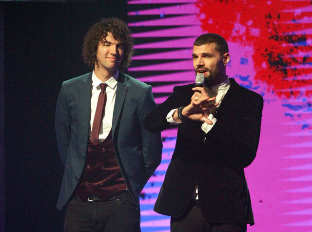 FILE - Joel Smallbone, right, and Luke Smallbone of For King and Country appear at the 47th Annual GMA Dove Awards in Nashville, Tenn. on Oct. 11, 2016. The brother duo earned their first artist of the year award at the Gospel Music Association's Dove Awards, which aired on Friday, Oct. 30, 2020, without an audience due to the COVID-19 pandemic. (Photo by Wade Payne/Invision/AP, File)