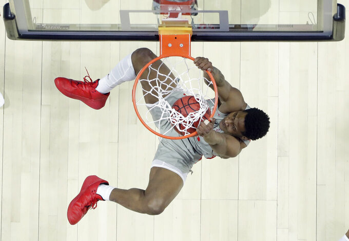 Houston's Brison Gresham dunks the ball during the first half of a first round men's college basketball game against Georgia State in the NCAA Tournament Friday, March 22, 2019, in Tulsa, Okla. (AP Photo/Jeff Roberson)