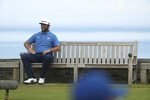 Spain's Jon Rahm sits on a bench by the 6th tee during a practice round ahead of the start of the British Open golf championships at Royal Portrush in Northern Ireland, Tuesday, July 16, 2019. The British Open starts Thursday. (AP Photo/Jon Super)
