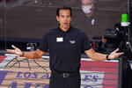 Miami Heat head coach Erik Spoelstra watches the action during the second half of an NBA conference final playoff basketball game against the Boston Celtics Friday, Sept. 25, 2020, in Lake Buena Vista, Fla. (AP Photo/Mark J. Terrill)