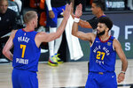 Denver Nuggets' Jamal Murray (27) celebrates with Mason Plumlee (7) during the first half of an NBA basketball first round playoff game against the Utah Jazz Sunday, Aug. 30, 2020, in Lake Buena Vista, Fla. (AP Photo/Ashley Landis)