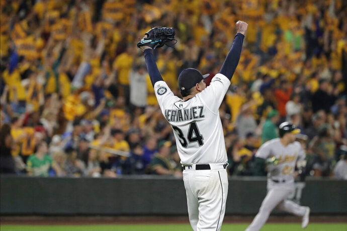 Seattle Mariners starting pitcher Felix Hernandez celebrates getting out of a bases-loaded jam to end the top of the fifth inning of the team's baseball game against the Oakland Athletics, Thursday, Sept. 26, 2019, in Seattle. (AP Photo/Ted S. Warren)