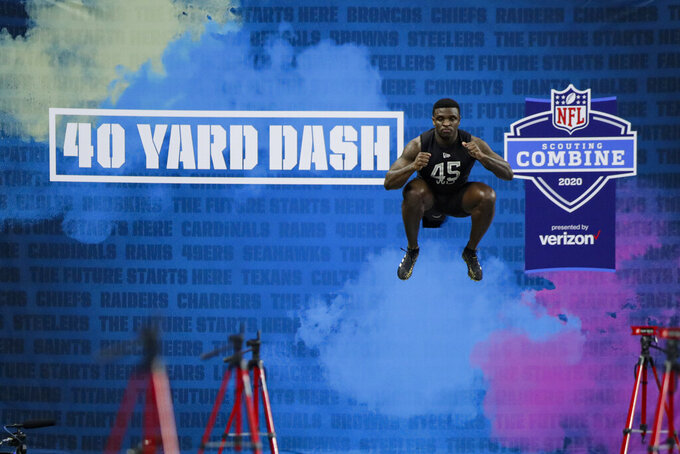 TCU wide receiver Jalen Reagor prepares to run the 40-yard dash at the NFL football scouting combine in Indianapolis, Thursday, Feb. 27, 2020. (AP Photo/Michael Conroy)