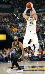 Indiana Pacers forward Doug McDermott (20) shoots the basketball near Brooklyn Nets guard Allen Crabbe in the first half of an NBA basketball game, Saturday, Oct. 20, 2018, in Indianapolis. (AP Photo/R Brent Smith)