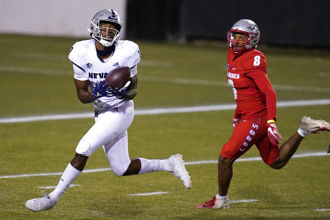 Nevada wide receiver Romeo Doubs (7) makes a touchdown catch over New Mexico cornerback Donte Martin (8)during the second half of an NCAA college football game Saturday, Nov. 14, 2020, in Las Vegas. (AP Photo/John Locher)