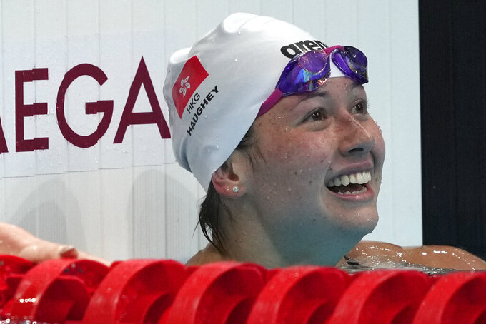 Siobhan Bernadette Haughey of Hong Kong smiles after the women's 200-meter freestyle final at the 2020 Summer Olympics, Wednesday, July 28, 2021, in Tokyo, Japan. (AP Photo/Matthias Schrader)