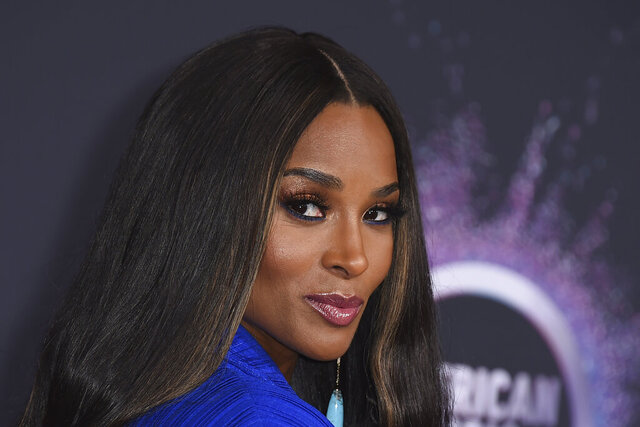 "FILE - In this Nov. 24, 2019, file photo, Ciara arrives at the American Music Awards at the Microsoft Theater in Los Angeles. Recording artist Ciara returned to the city where she launched her career to surprise students at an Atlanta-area STEM high school on Monda, Dec. 16, 2019. The R&B artist sat in on a class with students at Paul Duke Stem High, a Norcross school which focuses on science, technology, engineering and math education. Students there have been using computer coding skills to remix her songs such as ""Melanin""and ""Set."" (Photo by Jordan Strauss/Invision/AP, File)"
