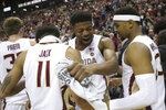 Florida State's Malik Osborne, center, celebrates with Nathanael Jack, left, and MJ Walker after clinching the ACC championship with a win over Boston College in an NCAA college basketball game Saturday, March 7 2020, in Tallahassee, Fla. Florida State won 80-62. (AP Photo/Steve Cannon)