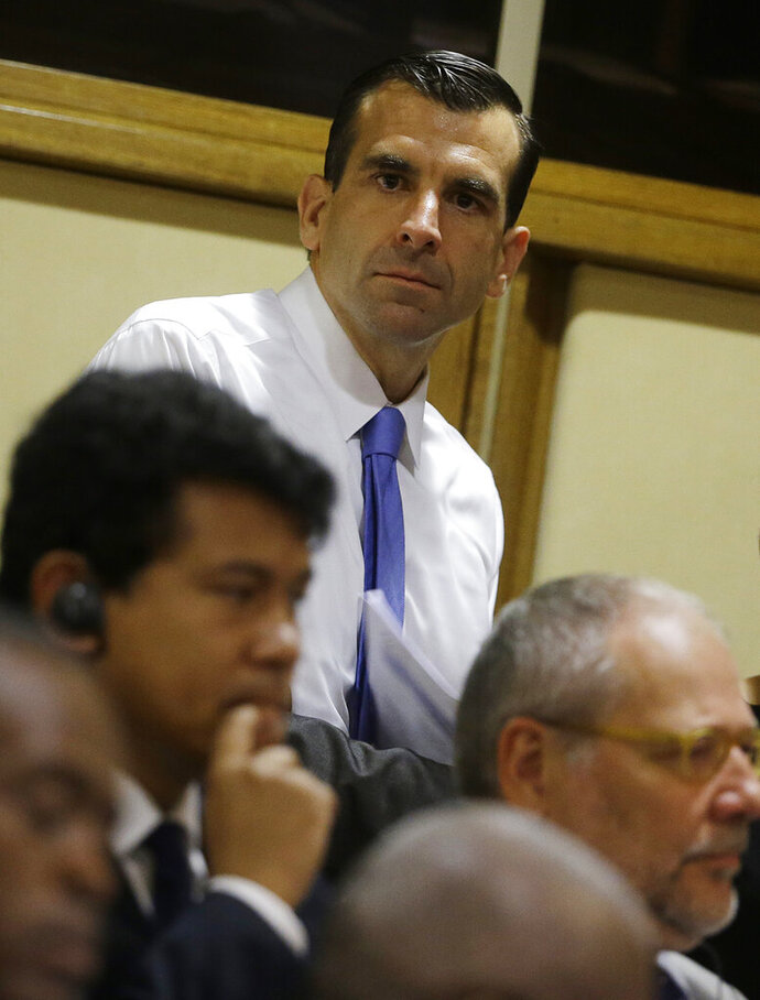 FILE - In this July 21, 2015 file photo San Jose Mayor Sam Liccardo, center, attends a conference on Modern Slavery and Climate Change at the Vatican. Liccardo, on Monday, Aug. 12, 2019, has proposed gun owners in the nation's 10th largest city to carry liability insurance to cover taxpayer costs associated with firearm violence. If approved, Liccardo's strict new measure would be the first of its kind in the nation to curb gun violence. (AP Photo/Gregorio Borgia,File)