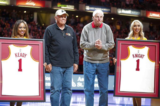 FILE - Former Purdue basketball coach Gene Keady, left, and former Indiana basketball coach Bob Knight are honored at halftime of an NBA basketball game between the Indiana Pacers and the New Orleans Pelicans in Indianapolis, in this Saturday, Feb. 8, 2020, file photo. Tony Hinkle turned Butler's pass-and-cut offense of the 1920s into a coaching textbook for generations. Bob Knight and Gene Keady added their own revisions following Hinkle's forced retirement in 1970. Today, those three remain the gold standard of basketball innovation in Indiana, a state where successful coaches have spent more than a century testing novel concepts, breaking barriers and polishing philosophies before introducing them America.(AP Photo/Michael Conroy, File)