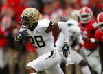 Georgia Tech's Juanyeh Thomas (28) returns a kick off for a touchdown during the first half of an NCAA college football game against Georgia Saturday, Nov. 24, 2018, in Athens, Ga. (AP Photo/John Bazemore)
