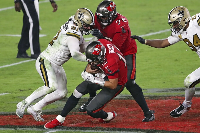 New Orleans Saints defensive end Trey Hendrickson (91) sacks Tampa Bay Buccaneers quarterback Tom Brady (12) during the second half of an NFL football game Sunday, Nov. 8, 2020, in Tampa, Fla. (AP Photo/Mark LoMoglio)