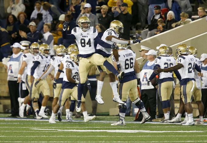 Navy's Tanner Matthews (84) and Aleksei Yaramus (86) celebrate a touchdown against Tulsa during an NCAA college football game, Saturday, Oct. 12, 2019, in Tulsa, Okla. (Stephen Pingry/Tulsa World via AP)