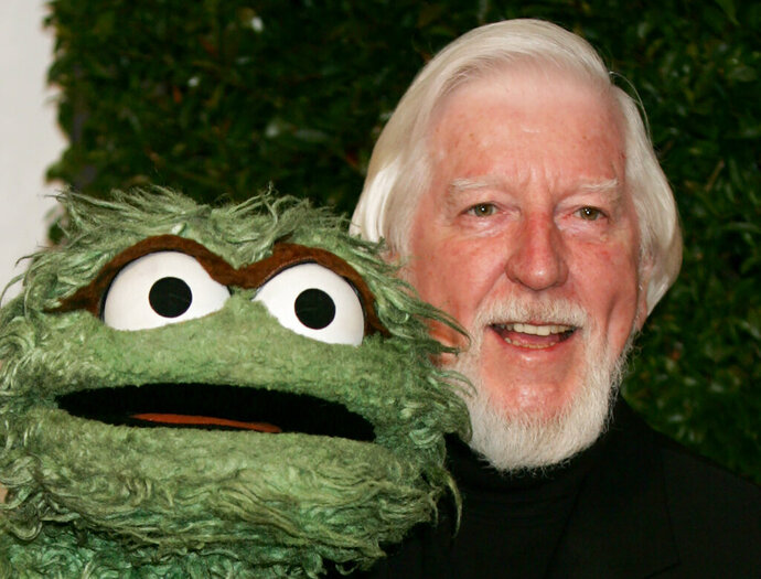 FILE - In this Thursday, April 27, 2006, file photo, Caroll Spinney, right, who portrays