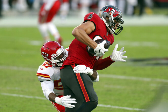 Tampa Bay Buccaneers tight end Rob Gronkowski (87) is stopped by Kansas City Chiefs defensive end Alex Okafor (57) during the first half of an NFL football game Sunday, Nov. 29, 2020, in Tampa, Fla. (AP Photo/Mark LoMoglio)
