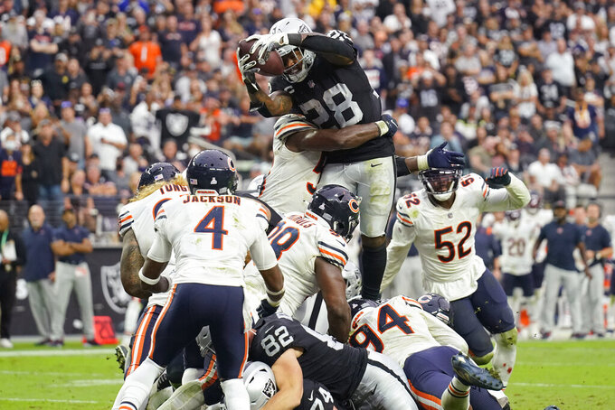 Las Vegas Raiders running back Josh Jacobs (28) scores a touchdown against the Chicago Bears during the second half of an NFL football game, Sunday, Oct. 10, 2021, in Las Vegas. (AP Photo/Rick Scuteri)