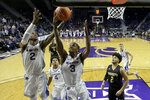 Kansas State's Cartier Diarra (2) and DaJuan Gordon (3) grab a rebound during the first half of an NCAA college basketball game against Alabama State Wednesday, Dec. 11, 2019, in Manhattan, Kan. (AP Photo/Charlie Riedel)