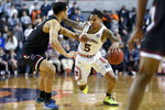 South Carolina guard Jair Bolden (52) defends Auburn guard J'Von McCormick (5) during the second half of an NCAA college basketball game Wednesday, Jan. 22, 2020, in Auburn, Ala. (AP Photo/Julie Bennett)