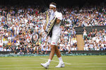Switzerland's Roger Federer wipes his face as he plays Serbia's Novak Djokovic during the men's singles final match of the Wimbledon Tennis Championships in London, Sunday, July 14, 2019. (Laurence Griffiths/Pool Photo via AP)