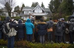Media wait for Meng Wanzhou, chief financial officer of Huawei, to leave her home to attend a hearing in Vancouver, Monday, January, 20, 2020. THE CANADIAN PRESS/Jonathan Hayward/The Canadian Press via AP)