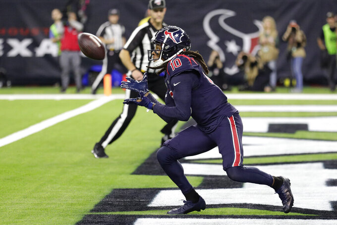 Houston Texans wide receiver DeAndre Hopkins (10) makes a catch for a touchdown against the Indianapolis Colts during the first half of an NFL football game Thursday, Nov. 21, 2019, in Houston. (AP Photo/Mike Marshall)