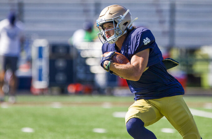 FILE - In this Aug. 8, 2019, file photo, Notre Dame's Chris Finke runs with the ball during NCAA college football practice in Culver, Ind. Notre Dame has an experienced wide receiver corps. (Robert Franklin/South Bend Tribune via AP, File)