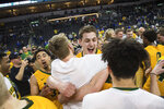 North Dakota State players celebrate after a win over Omaha during an NCAA college basketball game for the Summit League men's tournament championship, Tuesday, March 12, 2019, in Sioux Falls, S.D. (Loren Townsley/Argus Leader via AP)
