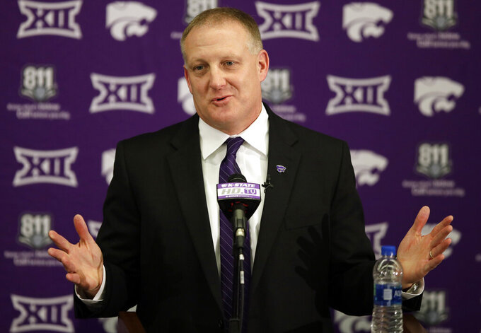 FILE - In this Dec. 12, 2018, file photo, new Kansas State NCAA college football head coach Chris Klieman speaks at his introductory press conference in Manhattan, Kan. Kansas coach Les Miles and Kansas State counterpart Chris Klieman wrap up their initial recruiting classes, both having hit the ground running in their new gigs.  (AP Photo/Orlin Wagner, File)
