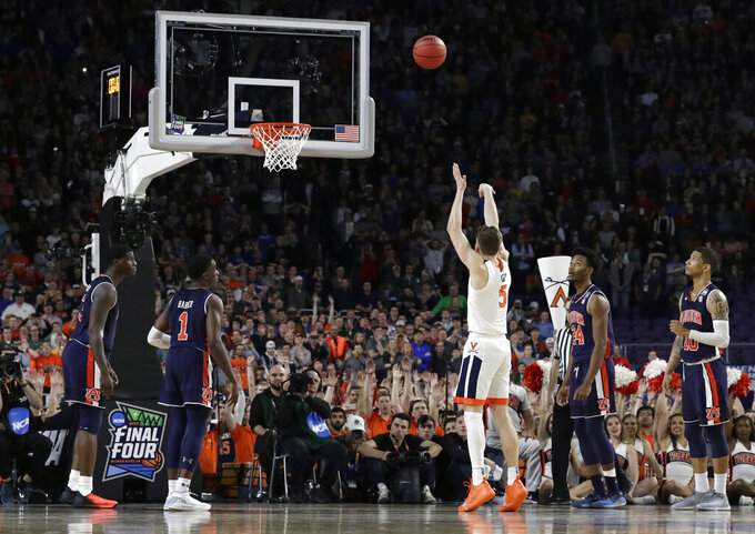 FILE - In this April 6, 2019, file photo, Virginia's Kyle Guy (5) shoots the last free throw to defeat Auburn 63-62 during the second half in the semifinals of the Final Four NCAA college basketball tournament, in Minneapolis. Lost somewhere amid all the agony at Auburn and euphoria at Virginia was the fact that sports are never fair. The tough call that helped push Virginia into the national final was the last of several bang-bang decisions referees had to make without the assistance of slow-motion replay or multiple camera angles. (AP Photo/David J. Phillip, File)