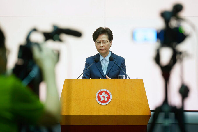 Hong Kong Chief Executive Carrie Lam listens to reporters' questions during a press conference in Hong Kong, Tuesday, May 25, 2021. Lam on Tuesday defended Hong Kong as an attractive place for businesses, after a recent survey found many foreigners were considering leaving the longtime Asian business hub. (AP Photo/Vincent Yu)