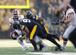 Iowa defensive lineman Brady Reiff, center, sacks Minnesota quarterback Tanner Morgan, left, during the first half of an NCAA college football game, Saturday, Nov. 16, 2019, in Iowa City, Iowa. (AP Photo/Matthew Putney)