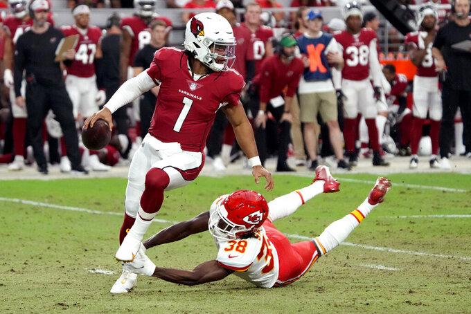 Arizona Cardinals quarterback Kyler Murray (1) scrambles as Kansas City Chiefs safety L'Jarius Sneed (38) pursues during the first half of an NFL football game, Friday, Aug. 20, 2021, in Glendale, Ariz. (AP Photo/Rick Scuteri)