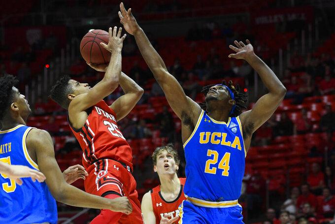 Utah guard Alfonso Plummer (25) shoots over UCLA forward Jalen Hill (24) during the second half of an NCAA college basketball game Thursday, Feb. 20, 2020, in Salt Lake City. (AP Photo/Alex Goodlett)