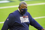 FILE - In this Sunday, Jan. 3, 2021 file photo, Houston Texans interim coach Romeo Crennel walks onto the field for an NFL football game against the Tennessee Titans in Houston. The Houston Texans have hired Lovie Smith as defensive coordinator, one of many new additions to first-year coach David Culley's staff, Wednesday, March 10, 2021. Romeo Crennel, who was the interim coach last season following Bill O'Brien's dismissal after an 0-4 start, will remain with the team as the senior advisor for football performance. (AP Photo/Eric Christian Smith, File)