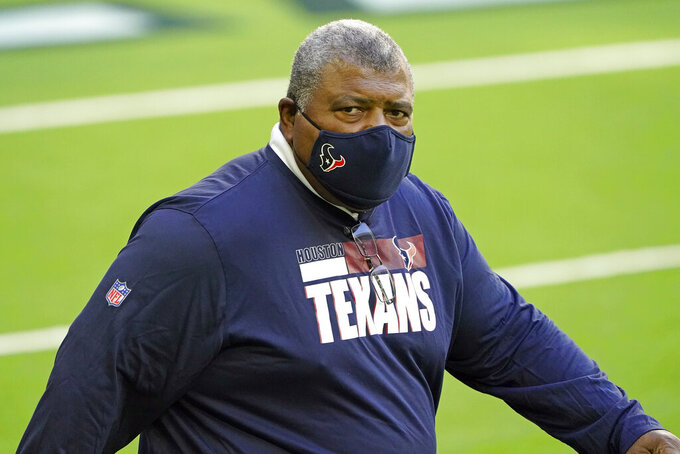 FILE - In this Sunday, Jan. 3, 2021 file photo, Houston Texans interim coach Romeo Crennel walks onto the field for an NFL football game against the Tennessee Titans in Houston. The Houston Texans have hired Lovie Smith as defensive coordinator, one of many new additions to first-year coach David Culley's staff, Wednesday, March 10, 2021. (AP Photo/Eric Christian Smith, File)